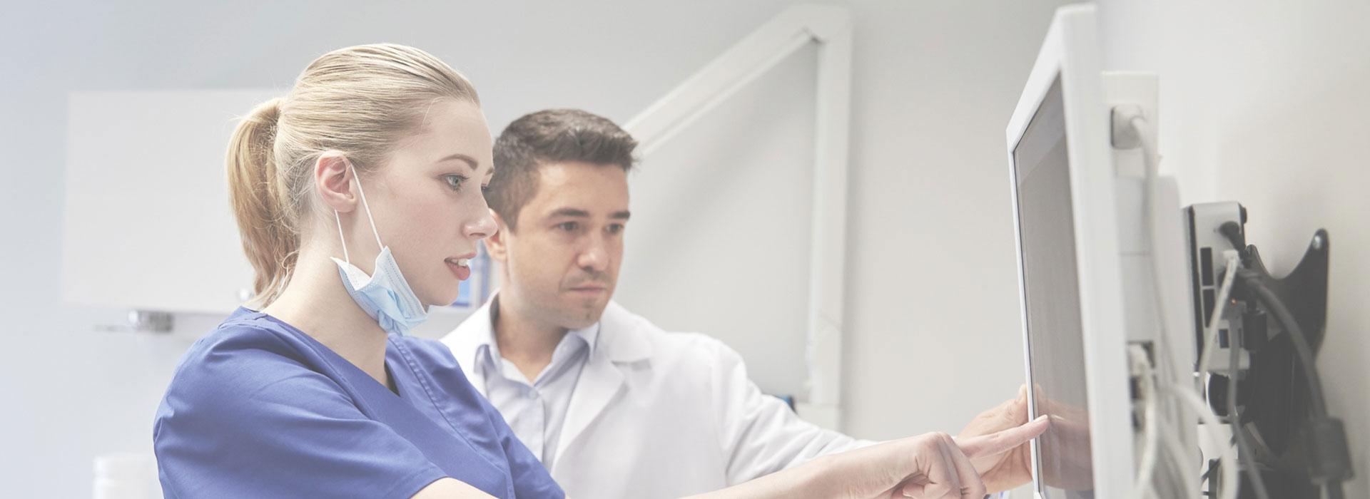 Dentist and nurse examining x-ray results