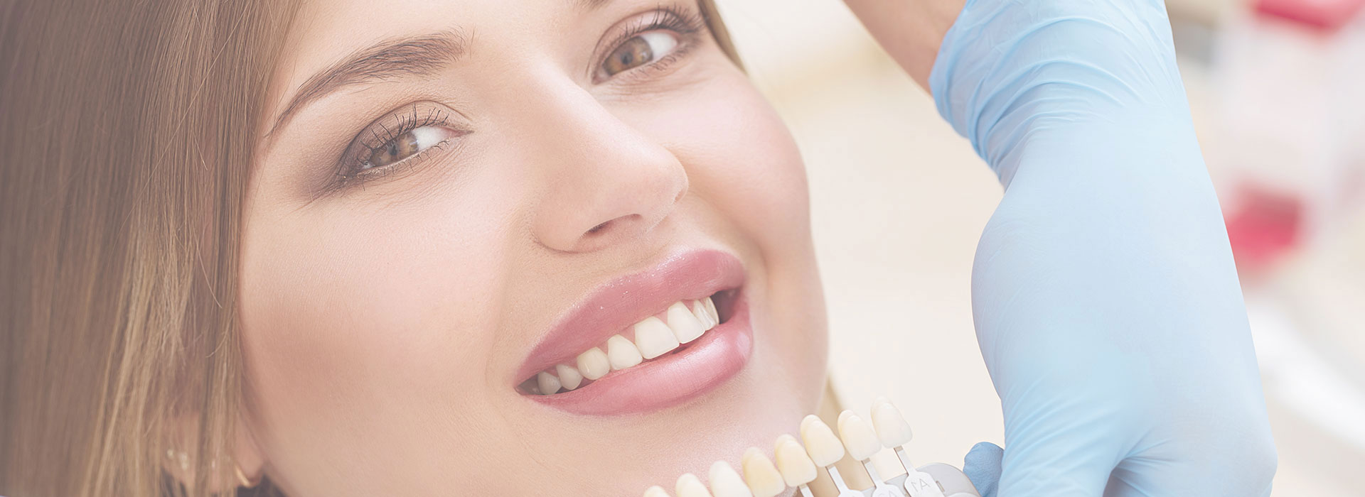 Woman smiling at dental clinic