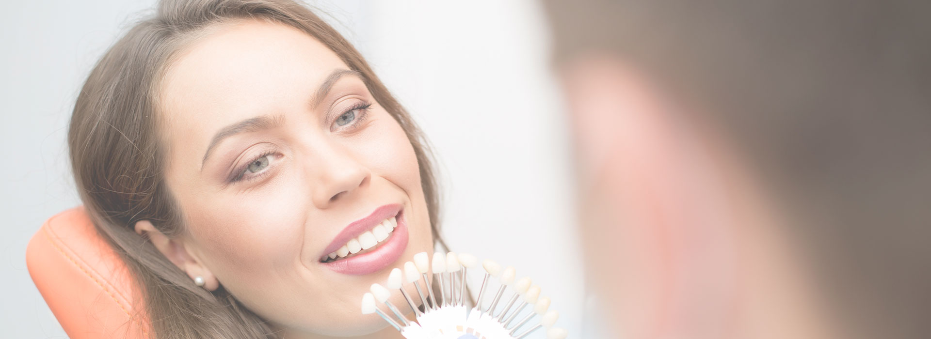 Woman smiling at the dental clinic